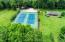 Community tennis courts, shelter house with fireplace, 3 hole golf course and 2 ponds.