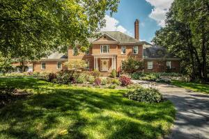 All brick exterior, circular asphalt drive, bridge over creek, gated entry, raised stone landscape beds, front porch lights, brick walkway & front porch, wooded & rolling lot, exterior dental crown molding, upgraded landscaping, irrigation throughout the grounds including back porch.