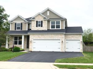 Beautiful curb appeal fully landscaped with a large front porch.