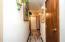 New porcelain tile flooring, new lighting, ivory painted walls, coat closet