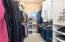 The closet offers built-ins from California Closet Systems