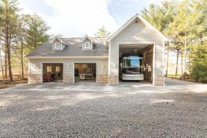 Brand new detached garage that can house a 45' RV! Water, septic and 200 amp panel.