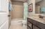 • Ceramic tile flooring • Mindful grey painted walls • Enclosed vanity with single bowl, cultured marble sinktop • 3 bulb wall light • Tub/shower combination with ceramic tile surround • Ceiling exhaust