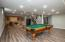 • New laminate flooring ~2017 • Silver strand painted walls • Can lighting • Pool table remains