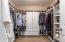 WOW!! Now that is a closet! Delight in having room for all your needs with shelves & loads of hanging space.