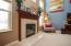 Gas fireplace with blowers to keep heat in the home if desired.