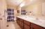 Hall bath with large double vanity.