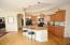 Pendent & Recessed Lighting for a bright kitchen area!