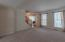 Formal Living Area with Crown Molding and Tons of Natural Light