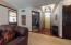 • Hardwood flooring • Tan painted walls • Barrel ceiling • Hanging chandelier • Transom and 1/2 round window