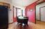 • Laminate flooring • Red painted walls • Hanging chandelier • Bay wall • Wall pantry