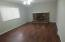 Family room with brick fireplace and laminate flooring