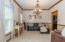 Dining Room (12' x 11'5) features crown molding, chair rail, and designer lighting