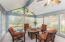 Sunroom (17'10 x 14'4) features cathedral ceiling, (2) lighted ceiling fans, and access to rear patio