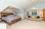Owner's Bedroom (18'11 x 12'10 + 11'10 x 8') features cathedral ceiling, and lighted ceiling fan