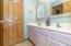 Ful Bath with double vanity, tub/shower combination, and dual entry