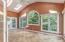 Sunroom (10'5 x 19'3) features shared fireplace, (3) sets of French doors, and vaulted ceiling with skylights