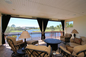 Curl up with a book and a refreshing drink and watch the golfers and the birds on the lake