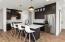 9' cabinets, hood, oversized island, quartz tops, tile back splash, upgraded sink