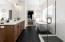 Glass enclosed tile shower, soaker tub, natural light, linen closet, double quartz vanity, private stool space