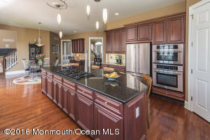 Gourmet Kitchen with Cherry cabinets & Granite center island with stools