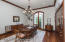 Grand Formal Dinning Room with custom built-in cabinets and soaring ceiling ht of 18+'