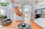 14 foot ceilings with twin ceiling fans in the bright formal Living Room
