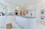 Custom built gourmet eat-in kitchen with beautiful white cabinetry, high ceilings, sub-zero refrigerator, Kitchenaid double oven, Kenmore Elite dishwasher, double sink, recessed lighting and an abundance of counter space!