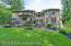 Four Sides quarry stone/stucco. Custom design home with arched windows, many entryways to home from the back. Fenced in private yard with separate area for pool if desired. Gas line run for heater.