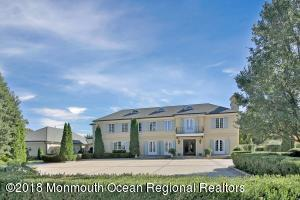 Majestically set high on 3.49 acres with water views
