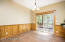 Eat-in kitchen with warm wood Wainscot accent