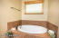 Large soaking tub. In addition master bath has a separate shower.