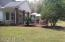 Huge covered back porch and paver patio with hot tub. Gas line for grill on porch.