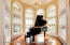 Conservatory with floor to ceiling windows perfect for a Piano room or sitting area.