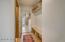 Mudroom w custom storage & garage & side yard entrances; Powder Bath
