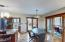 Kitchen dining area with door to deck and to the screen enclosed porch