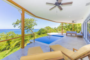 Step out of the indoor living area to the extending outdoor living space including covered wrap around patio and pool area