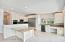 Gourmet Kitchen With Built-In Granite Table & Built-In Desk