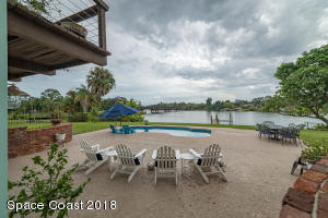 propane heated pool with view of Eau Gallie River