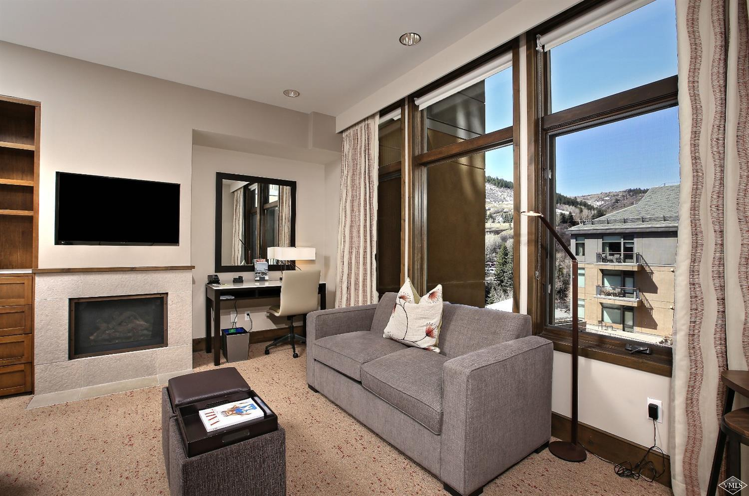 Studio Plus floor plan acts as a 1 bedroom and is more spacious than other studios. There is a small kitchenette area and dining table to seat 4. Views overlooking the pool & Eagle River.