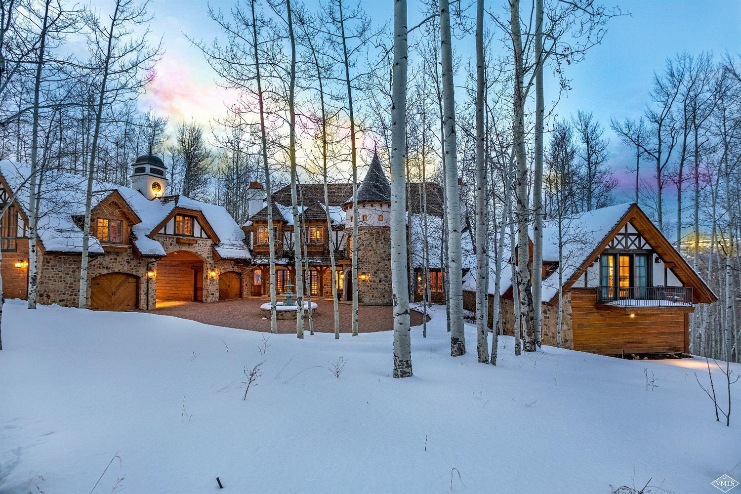 Located within the gates of prestigious Pilgrim Downs lies an enchanting 10,000 SF English estate. Soak in the sights of colorful gardens, Monet bridge atop a cascading creek, and sprawling Aspen trees all set upon 10 acres and only minutes to the ski slopes, golf courses and amenities of a world-class ski resort. Constructed by Beck Builders and fashioned after a castle in Normandy, this treasure is not to be missed! http://mls.pilgrimdownsestate.com/
