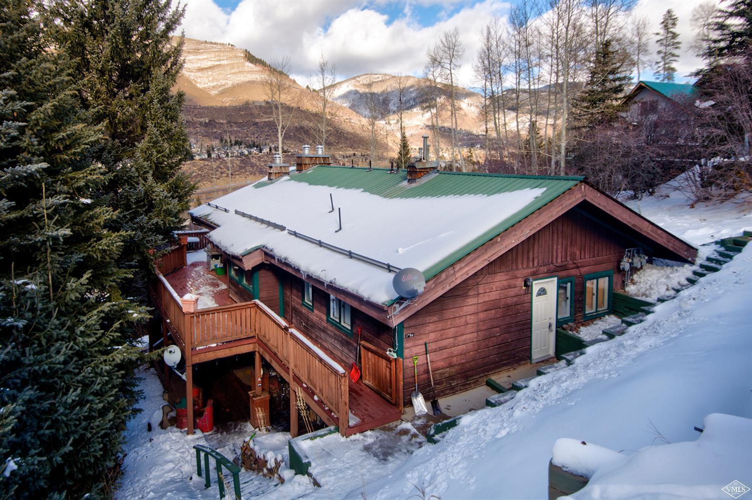 This classic West Vail home is situated on a flat lot with great views, small stream, and mature landscaping offering privacy. A perfect setting for an end user, who might enjoy receiving some income, or an investor as this home has four units which may be rented. Using current market rates, an estimated monthly rate could $7,5000. Its just a short walk to the TOV bus and this is a great long, or short term rental investment opportunity.
