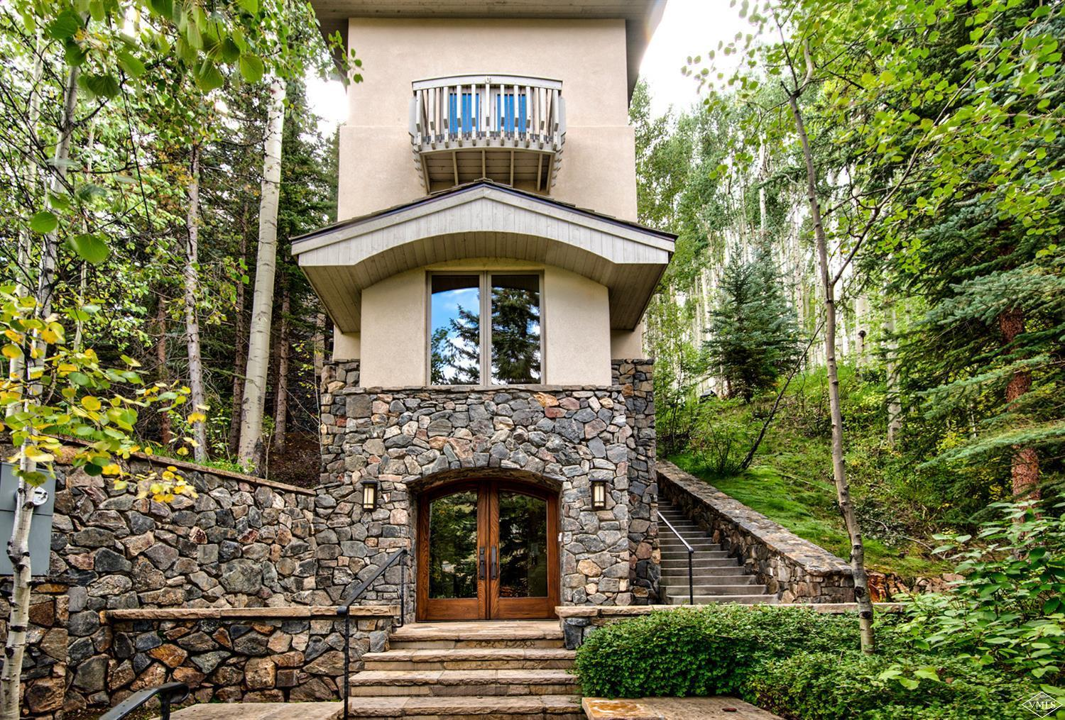 $549,000 PRICE REDUCTION!  Welcome to 636a Forest Road located just a short walk to Born Free ski run and perched amongst the tall pines of Vail ski mountain. Enter via a heated front entry and driveway off of Vail's coveted West Forest Road.  Access the elevator from the ground level (garage and ski storage) and exit on the third level where you will find a beautiful gourmet kitchen with hearth room, two family rooms featuring a wood burning fireplace, formal dining area and powder bathroom.  Adjacent to the kitchen and breakfast nook there is a lovely heated patio with sunken hot tub and entertaining space providing an amazing alpine outdoor experience.  The spacious great room is ideal for entertaining and offers a separate space for reading or relaxing. On the top level guests will find the primary master suite which backs to the aspens and spruce trees.  The suite features a fireplace, walk-in closet, deck and elegant bathroom with steam shower, heated floors, jetted tub and private rear patio for convenient access to the outdoor hot tub.  Additional features include a secondary master suite, custom bunk room, large laundry room, ample 2-car garage with space for 2-3 cars on the heated driveway.  This luxurious 6-bedroom, 5 1/2 bath home has been completely remodeled by a prominent Vail interior designer and is offered fully furnished.
