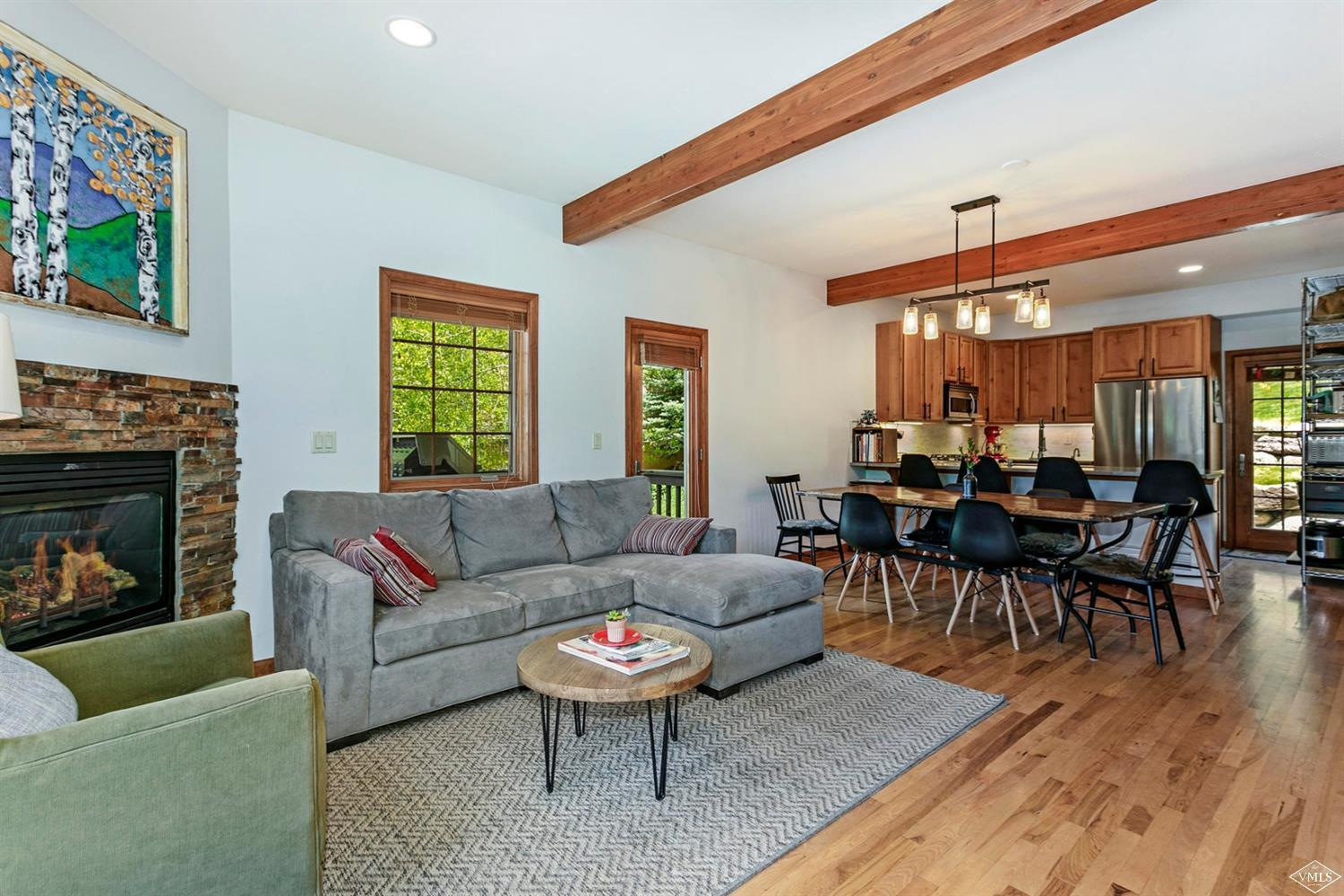 Wonderfully located end-unit 3-bedroom townhome in downtown Minturn. This home offers views, new water heater, one-car garage plus additional surface parking and living space that accommodates a dining table. The unique 3- level floor plan offers a bedroom on the entry level and the living area features 2 decks, a yard and remodeled kitchen with new appliances. An ideal layout for roommates. Recent upgrades to the building include new roofs, insulation, heat tape and gutters.