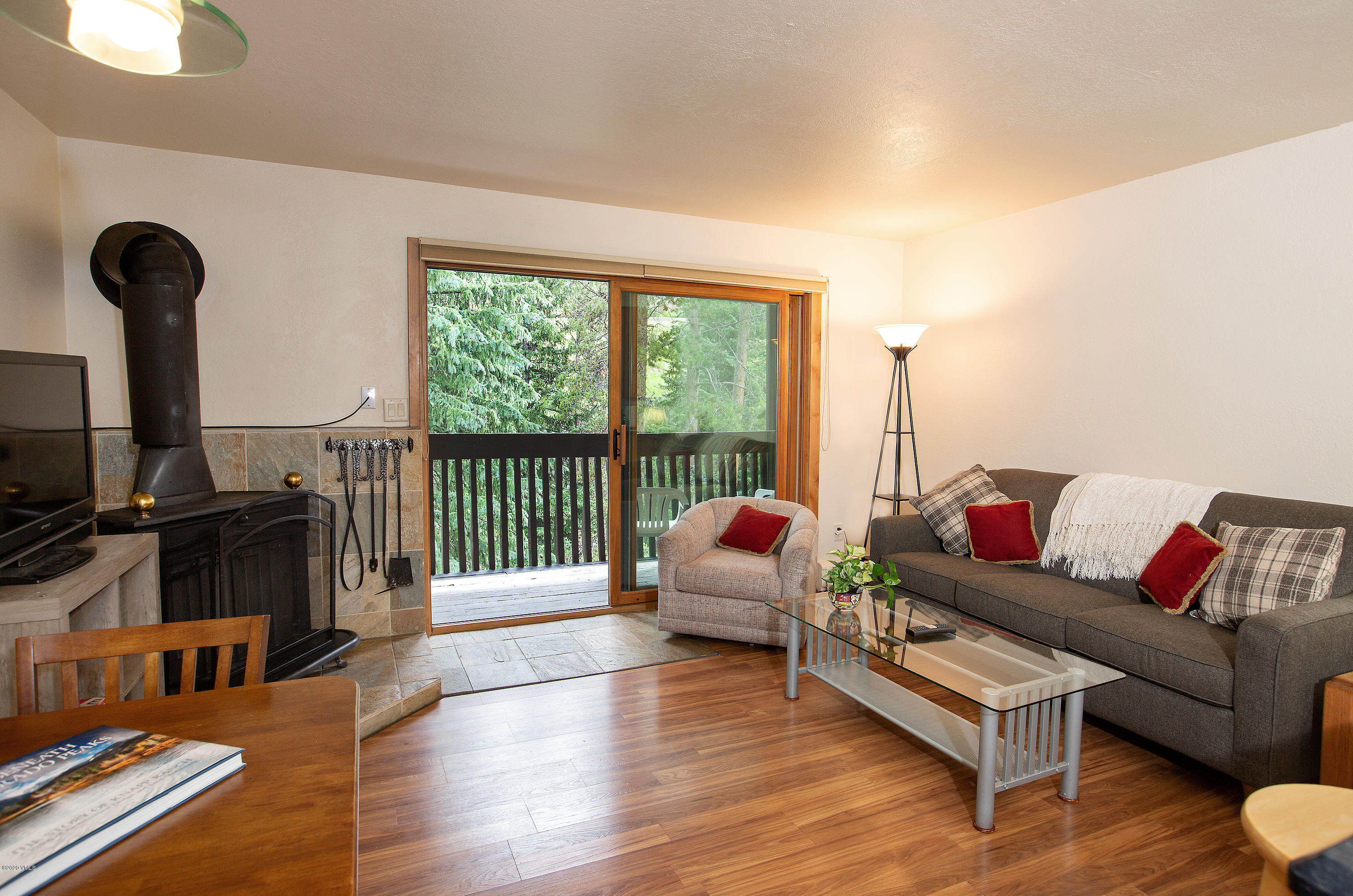 This sunny creek-side condominium is fresh and updated. New paint, wood floors, wonderful cabinets, and wood work throughout. Some nice furniture and easy to rent. Ready to show anytime.