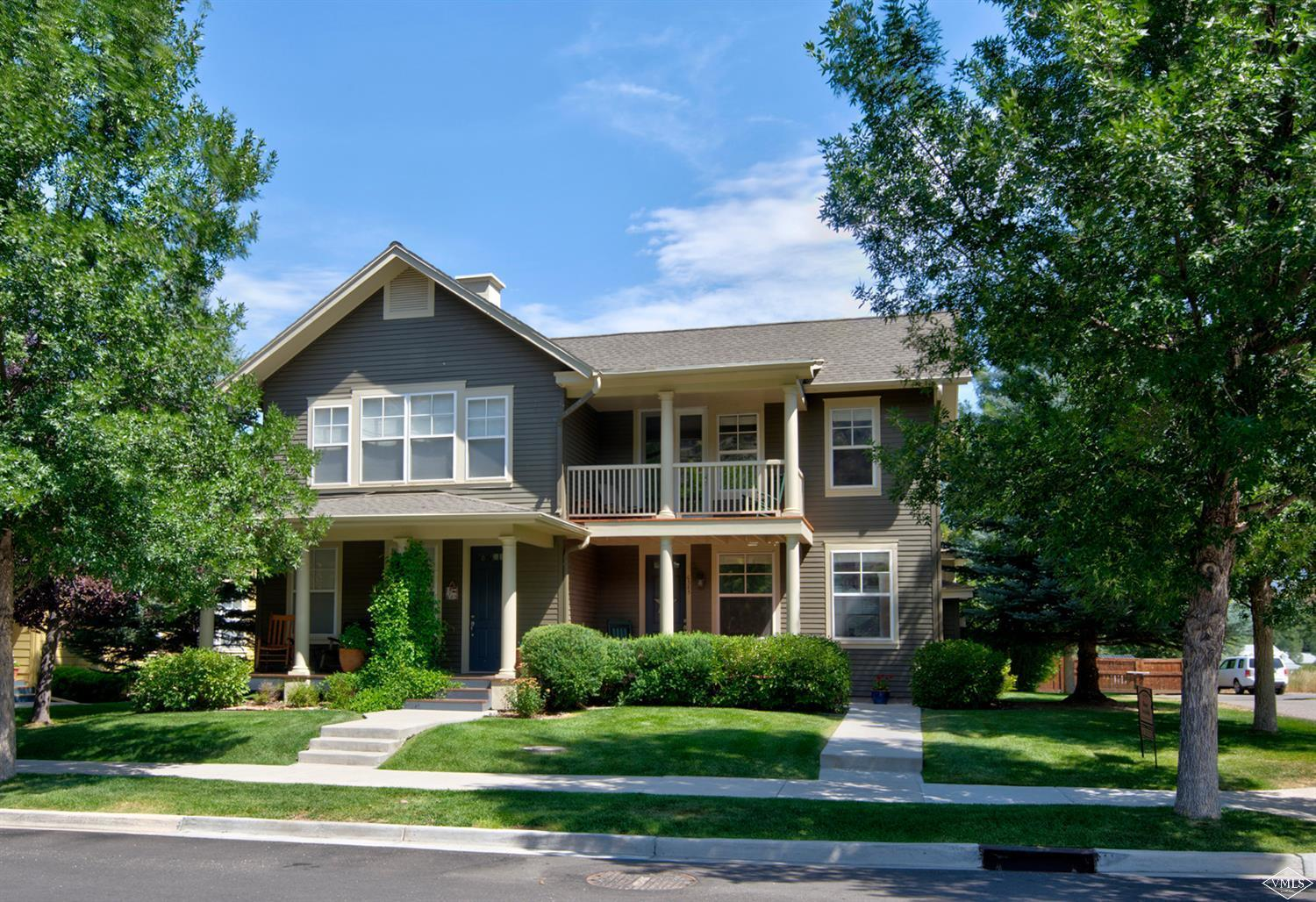 Enjoy the ultra convenience of this recently updated 4 bedroom home adjacent to dedicated open space. Step outside to the Eagle Ranch walking path, and only 2 blocks to the amenities of Eagle Ranch. New hardwood flooring, granite kitchen counter tops, fresh paint and carpet highlight a wonderful family home in a modern and beautiful, quintessential Colorado neighborhood. 1 car garage and secondary living area downstairs. Exteriors and outdoor spaces maintained by the HOA.
