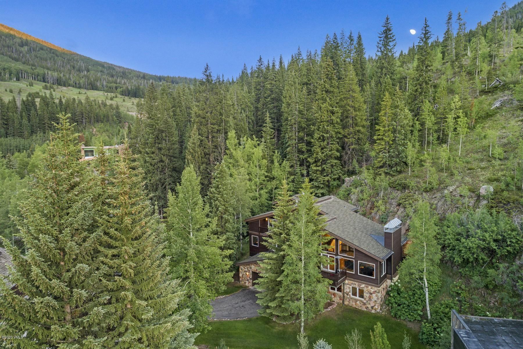 A spacious Alpine retreat tucked onto the mountainside in East Vail.  Uniquely situated for ultimate privacy and convenient access to Vail & Lionshead villages as well as world-class skiing, hiking and biking. Meticulously maintained with oversized windows, staircases and hallways and an open concept on the main floor with cathedral-like ceilings. Premium kitchen cabinetry and stainless-steel appliances plus a fourth-floor master suite and coveted oversized 2-car garage with additional storage.