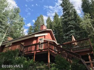 House is outside the town of Vail limits so no transfer tax.   It has to follow rules and laws of eagle county not town of Vail.  Owner has architectural and engineering  plans for oversize 2 car garage with living space above.    Property has a parking easement for property to access parking area.
