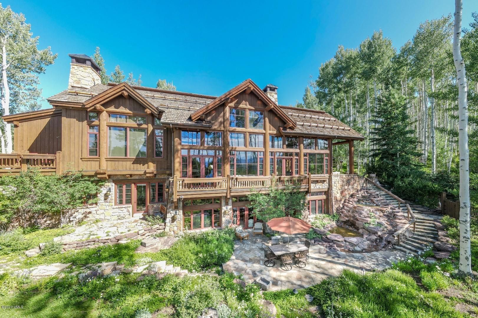 ''We watch foxes, pine martins, squirrels, deer, elk, birds especially hummingbirds.   We see all of this wildlife right out our windows.''-Homeowner .................... A rare, once in a generation opportunity to own a secluded luxury estate situated on top of the world only minutes to Vail and Beaver Creek, Colorado.  An air of grandeur pervades the over 10,000-square-foot alpine retreat, with every space warm and welcoming.  Inspired by travel, art and nature and designed by celebrated architect Paul Miller, this home features rich and sophisticated tones, exceptional quality of construction, generous scale and warm and inviting interiors that will satisfy the most discerning of tastes.  After entering the private gate, revel in the tranquility and serenity as you climb within Mountain Star to an elevated setting through the lush landscape and aspen groves and arrive at the residence.  Welcome to 208 Shooting Star.  Some of the many exceptional features of this this property include colossal views of the surrounding mountain peaks, magnificent entertaining areas, sophisticated wine room, 8 hallmark fireplaces all hidden in a flourishing aspen forest and greenery of the landscape with 2 enchanting water features. .................... Enveloping the residence are an abundance of wonderful outdoor living spaces, each of which has been thoughtfully positioned for the ultimate enjoyment of the views and soothing surroundings.  Breath in the fresh air, stroll through the soft rolling topography and simply take it all in.  Privacy and enchantment await.  Spend a week or spend a lifetime, you will not be disappointed.