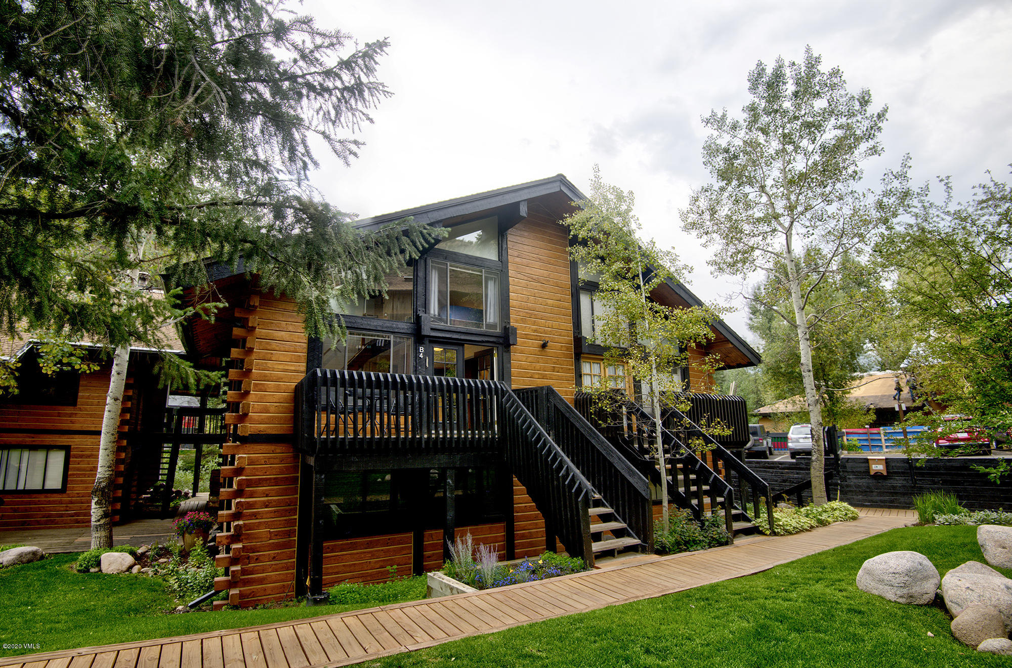 Super cute, remodeled sunny 2 bedroom 2 bathroom condo in popular Intermountain. Newly furnished with fresh paint, contemporary accents, vaulted ceilings, wood floors, granite, sky lights and updated bathrooms.   HOA dues include heat, internet and cable plus just steps from the free town of Vail bus stop. Proven strong rental producer to offset your sweet mountain retreat or enjoy as a primary home. Ideal setting next to the Gore Creek, with no I 70 impact, yet only a short bus ride away to hit the slopes or cruise the village for entertainment, dining and shopping.